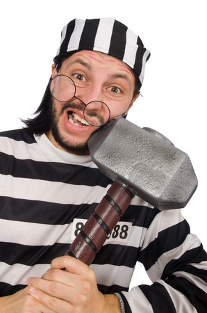 escaping: Prison inmate with hammer isolated on white Stock Photo