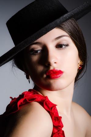 woman wearing hat: Woman wearing hat against dark background