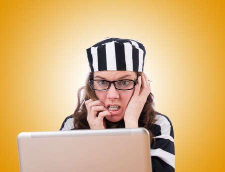 criminal: Criminal hacker with laptop on white Stock Photo