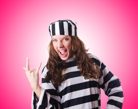 prison ball: Convict criminal in striped uniform Stock Photo
