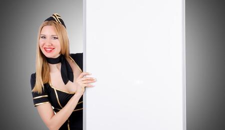 stewardess: Woman stewardess with blank board