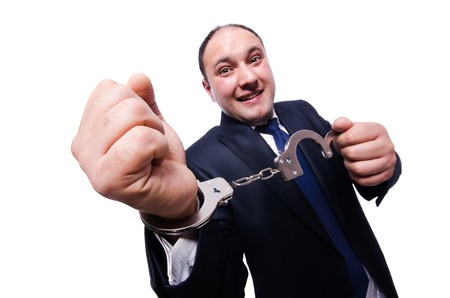 handcuffed: Businessman handcuffed isolated on white Stock Photo