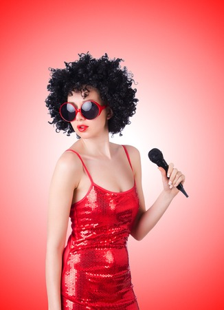 pop star: Pop star with mic in red dress against the gradient