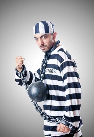 convict: Convict criminal in striped uniform Stock Photo