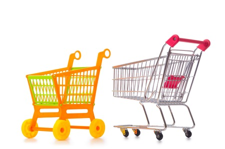 carro supermercado: Shopping supermarket trolley isolated on the white Foto de archivo