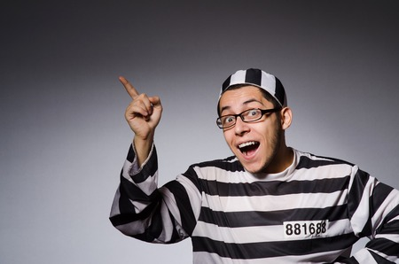 remand: Funny prisoner isolated on gray Stock Photo