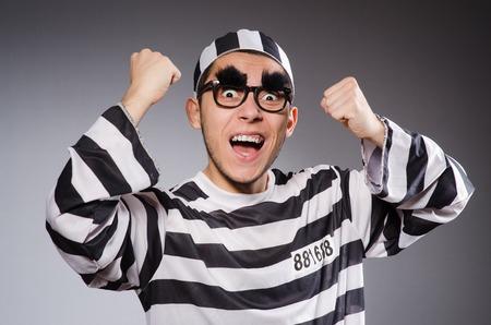 fraudster: Funny prisoner isolated on gray Stock Photo
