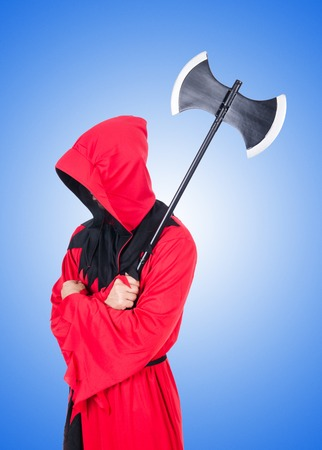 executor: Executioner in red costume with axe against the gradient