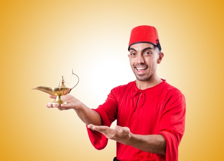 turkish man: Turkish man with lamp against the gradient Stock Photo