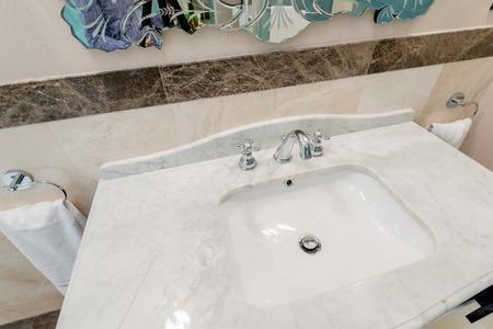 to sink: Modern elegant sink in bathroom Stock Photo