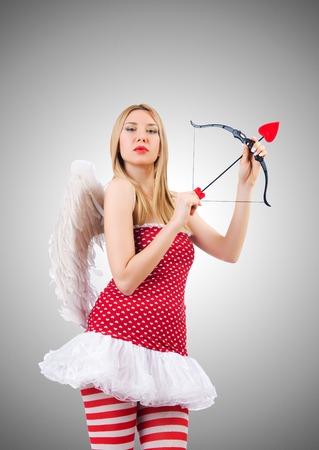 valentine cherub: Woman with bow in valentine concept