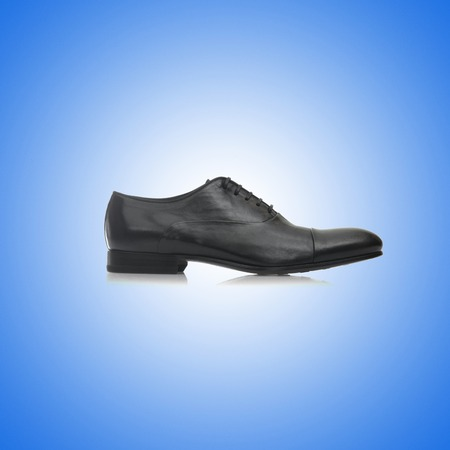 mules: Fashion concept with male shoes against gradient