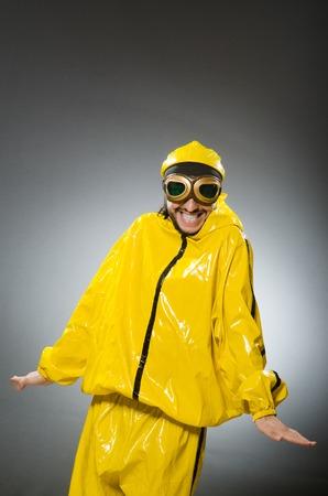 adventure aeronautical: Man wearing yellow suit and aviator glasses