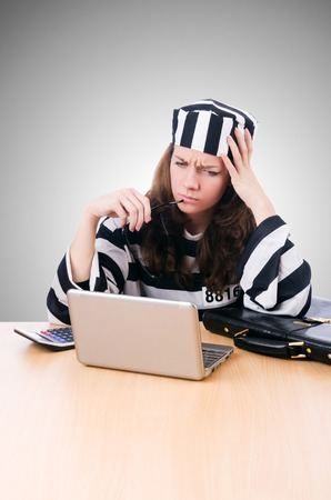 lawbreaker: Criminal hacker with laptop against the gradient Stock Photo