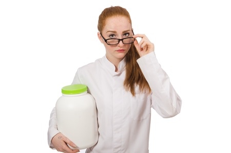 Young female doctor holding jar of protein isolated on white Stock Photo