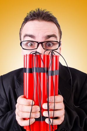 dynamite: Businessman with dynamite against the gradient Stock Photo