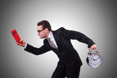 time bomb: Man with time bomb against the gradient Stock Photo