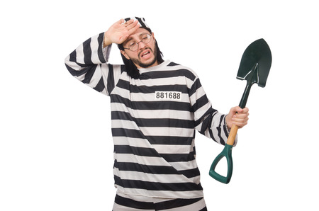 Prison inmate with spade isolated on white Stock Photo