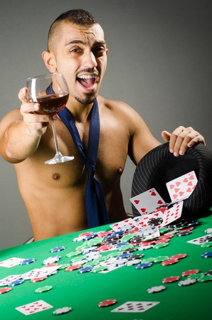 hold em: Man drinking and playing in casino
