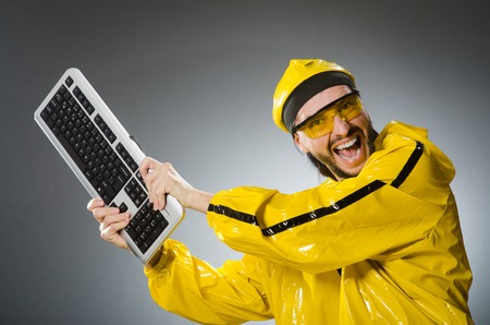 computer dancing: Man wearing yellow suit with keyboard