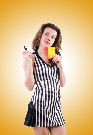 arbitrator: Woman referee with card against the gradient