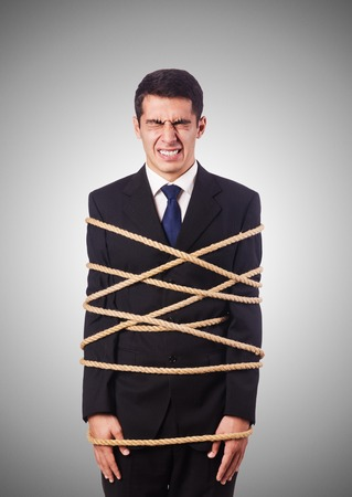 roped: Businessman tied up with rope against gradient