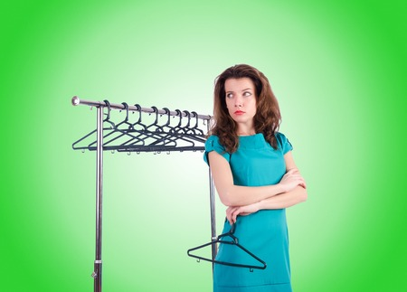 clothing stores: Woman trying new clothing against gradient Stock Photo