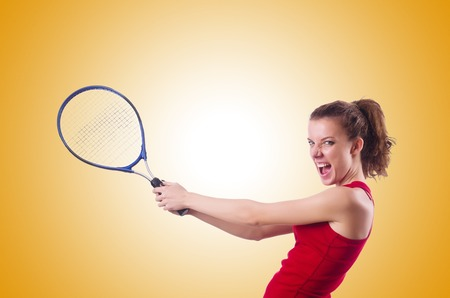 Raquet: Woman playing tennis against the gradient Stock Photo