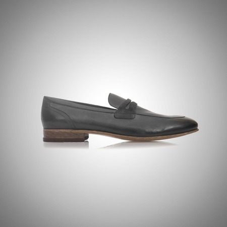 footgear: Fashion concept with male shoes against gradient