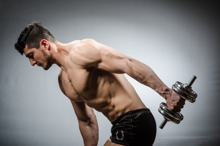 ripped: Muscular ripped bodybuilder with dumbbells Stock Photo