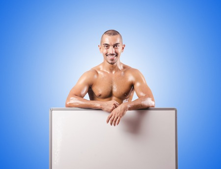 half naked: Half naked man with blank board