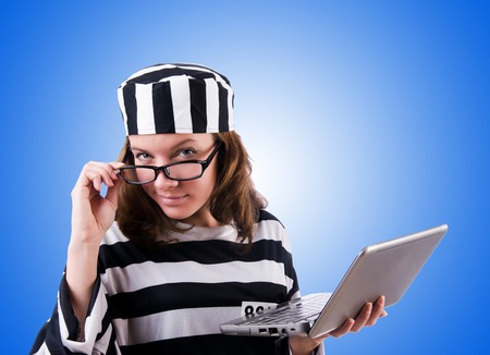 lawbreaker: Criminal hacker with laptop against gradient Stock Photo