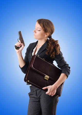 hand gun: Woman businewoman with hand gun Stock Photo