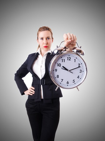 office time: Woman businesswoman with giant clock