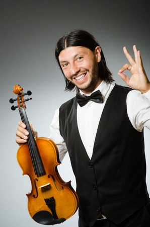virtuoso: Man playing violin in musical concept