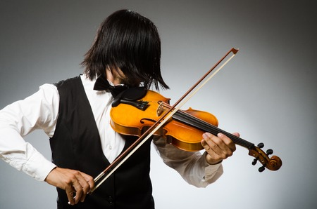 fiddlestick: Man playing violin in musical concept