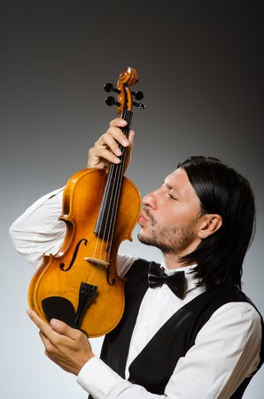 solo violinist: Man playing violin in musical concept