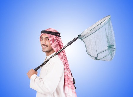 catching: Arab businessman with catching net against gradient