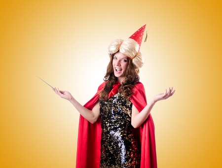 conjuror: Female magician against the gradient Stock Photo