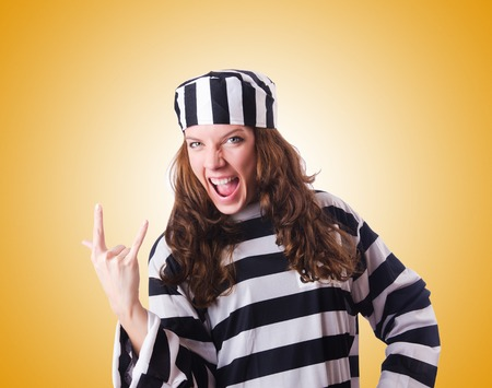 convict: Convict criminal in striped uniform Stock Photo