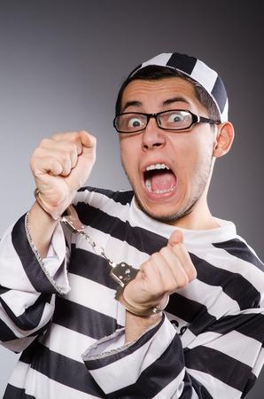 fetter: Funny prisoner isolated on gray Stock Photo