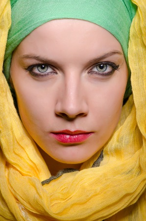hijab: Serious woman wearing colourful headscarf