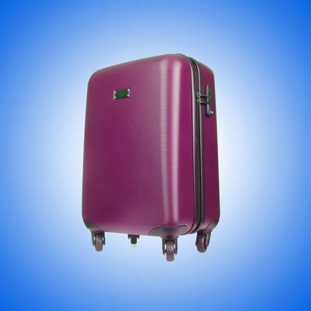 fondo degradado: Travel luggage against the gradient background