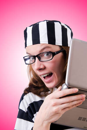 criminal: Criminal hacker with laptop against gradient Stock Photo