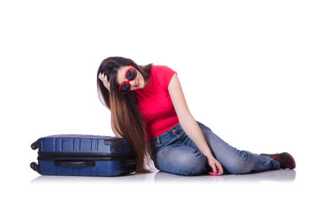 distress: Pretty girl with suitcase isolated on white