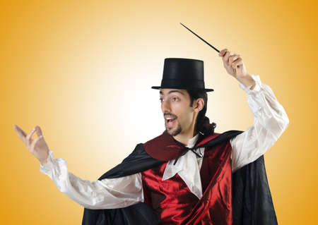 conjuror: Magician doing tricks on white Stock Photo