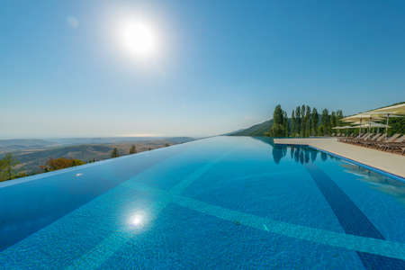 Infinity pool on the bright summer day Imagens