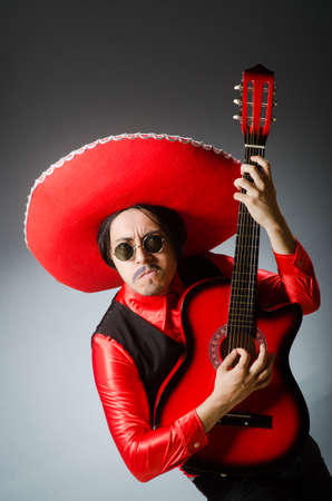 brandishing: Mexican guitar player in red Stock Photo