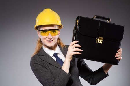 architector: Construction worker in helmet against gray Stock Photo