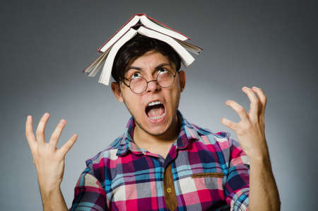 frustrated: Funny student with many books Stock Photo
